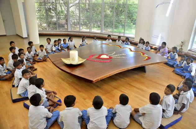 21 September 2015: School children sitting in meditation around the Peace Table on International Peace Day